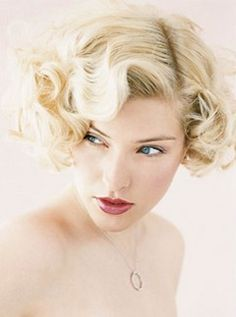 curly short bridal hairstyle with curly side bangs