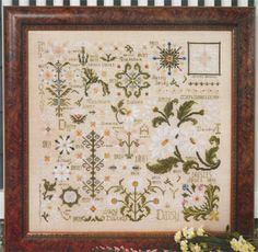 Rosewood Manor Dreaming of Daisies - Cross Stitch Pattern. Model stitched on 32 Ct. Parchment linen with Weeks Dye Works floss. Stitch Count: 198x198.