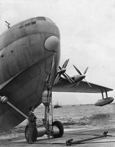 19th August 1952: Chief test Pilot Geoffrey Tyson standing by a 140 ton Saunders-Roe 'Princess' flying boat prior to flight trials. The plane is powered by ten Proteus 600 series 'jet prop' engines, can cruise at 350 mph and will take over a 100 passengers.