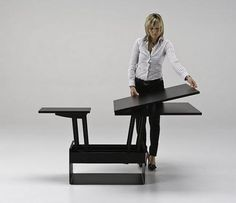the passo is a transforming coffee table with glass/wood top and