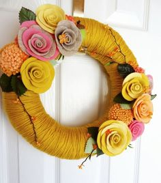 Gold Yarn and Felt Flowers wreath - love the color palette!