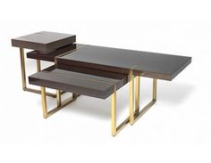 NEST OF 3 STRATA COFFEE TABLES 3-tables of varing dimensions and shapes nested together finished in high gloss chocolate walnum, charcoal and mink lacquer with brass legs and inlayed details. Custom to Specification: