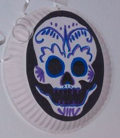 Making Day of the Dead masks helps kids have fun and learn about Mexico's traditional celebration!