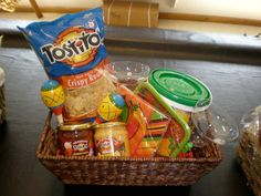 My signature basket for wedding showers. Basket from T.J. Maxx, margarita mix, chips, salsa, and queso from the grocery store, Fiesta plates, maracas, and margarita glasses from the party store...fill with red/orange/green/yellow shredded paper and Ole!