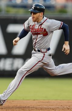 Freddie Freeman #5 of the Atlanta Braves advances to third base in the third inning of a game against the Philadelphia Phillies at Citizens Bank Park.