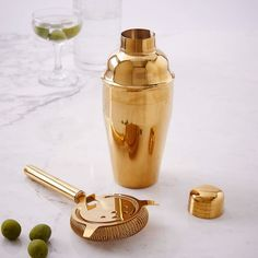 Our Gold Cocktail Shaker + Strainer aren't made from the real deal, but they sure look like they are. Add a set to your home bar or give it as a gift.