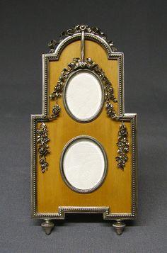 Picture frame by Carl Fabergé, workmaster: Viktor Aarne, before 1896, in holly wood with silver gilt ribbon gadroons and edging