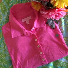Lilly Pulitzer Hotty Pink Trophy Polo Shirt Great for school. Great for work. Great for a lunch date. Great for golf. This bubblegum pink polo is surely FABULOUS for anything! Brand new with tag {not attached.} Featured in a very lightweight pima cotton. Lilly buttons and signature palm logo {in green} on front. Retired style. Lilly Pulitzer Tops
