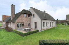 Exclusieve vierkantshoeve in de Vlaamse Ardennen