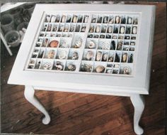Accent table with a shell collection by xenasdad on Etsy.  I would love to make something like this for my living room.