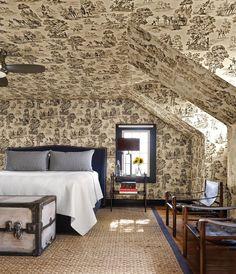 Toile wallpaper creates a vintage feel.