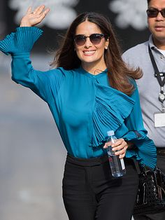 The always-gorgeous Salma Hayek waved to fans in shady style! Gotta love her feminine Clubmaster-inspired sunnies!