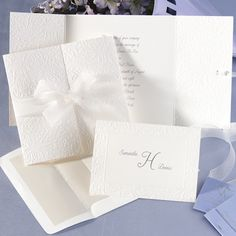 Pretty deep embossed all white folded invitation.  Very classic wedding.  $175 for 100