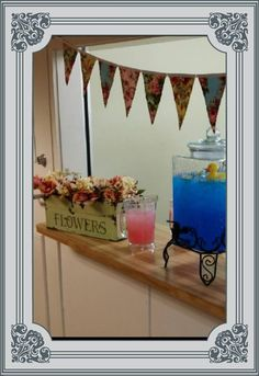 Twin's baby shower. One boy and one girl. Serve pink lemonade and blue Hawaiian drink (blue raspberry lemonade Kool-aid mixed with ginger ale).