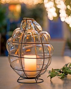 Toulouse Blown-Glass Lantern shown with flameless LED candle.
