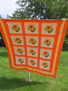 https://flic.kr/p/mPcpC | BRIGHT 70's QUILT | There it is...my first-ever full-sized quilt!  What can I say?  It was the 70's, 1975, to be exact.  And I was bored. So my mother gave me these appliqued blocks to work on.  She had purchased them from Herrschner's as a kit with fabric pieces included for the flower parts.  I went to work on them, using my break time at B&W Sporting Goods to work on the blocks.  Then when all the blocks were completed, we went shopping at Montgomery Wards in...