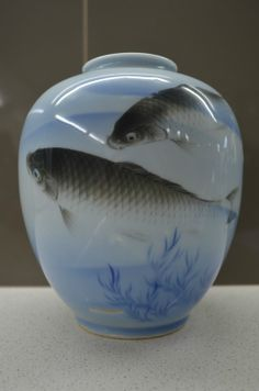 Hand Painted Meiji Period c.1890 Japanese Fukagawa Vase. This example depicts traditional Japanese Koi fish swimming amongst aquatic plant life.