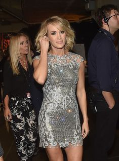 """Carrie Underwood - Sparkled in a silver mini dress during her performance of """"The Fighter"""" with Keith Urban 