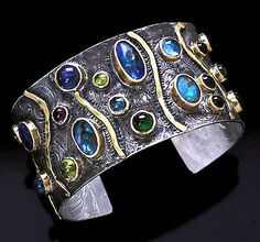 Cuff | Laurie MacAdam.  Boulder Opal, Iolite, Tourmaline, Peridot, Apatite, Blue Topaz, Amethyst,  Sterling Silver and 14 Karat gold