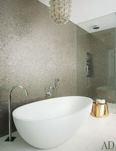 Sparkle and dazzle all your guests with this stunning home decor bathroom inspiration. The soft gold tiles & white bathtub make this bathroom feel extremely luxurious and chic. Bathroom Wall, Bathroom Interior, Master Bathroom, Bathroom Ideas, Mosaic Bathroom, Bling Bathroom, Bathroom Designs, Bathroom Fixtures, Bathtub Ideas