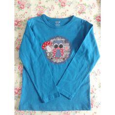 T-shirtje Turquoise lange mouw met uiltje en paddenstoel. Maat 110/116