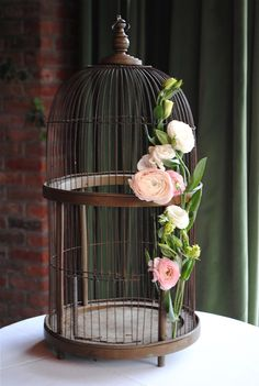 Birdcage with flowers.   Rebecca Shepherd floral design: Bowery Hotel wedding flowers.