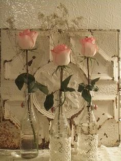 Love the metal tile behind the flowers and the lace on the bottles ~ pretty together.