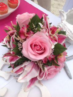 Stargazer lily with pink roses #stthomaswedding #stthomasweddingplanner #beachweddingsetup #beachweddings #flawlessweddingsandeventvi #cruiseshipweddings http://www.flawlessweddingsandeventsvi.com/portfolio/floral-gallery