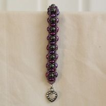 Purple fresh water pearls and hematite make for a stunning bracelet. It has a heart shape toggle for a clasp.