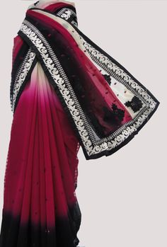 Cast a spell with this dazzling creation. This saree in shaded red and black color is crafted in Georgette material.  #lka #fashion