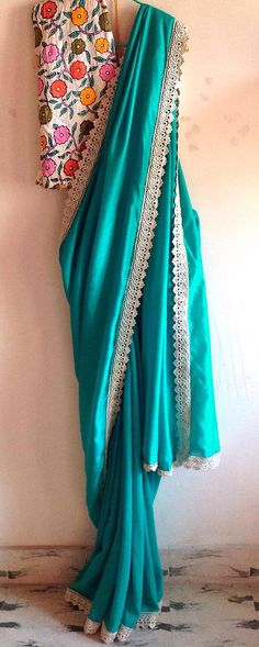 Teal green semi crepe saree lace border and by GiaExquisiteIndian
