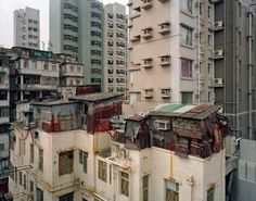 Since the land area is limited in hong kong, slums are settled on rooftops.
