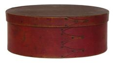 Oval Box - Maple and pine, original cherry red painted finish, four fingers, good patina, medicinal herbs fragrance inside, 4 1/4″ h, 11 1/8″ l.