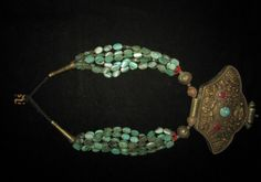 Antique turquoise necklace with large Ghau (with compartment).