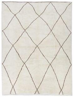 Berber rug from The Handmade Rug Company. Moroccan Atlas Berber Rugs - Handmade by Berber the tribes in the mountains of Morocco. Imported direct from the Beni Ourain & Moyen tribes in Morocco. Distinct, abstract lines, obtained by knotting dark yarn over light, make up the minimalist patterns and totemic symbols of protection found in each Berber carpet. Berber tribes of Morocco's Middle Atlas Mountains who roamed at such high altitudes that their flocks were forced to develop a…