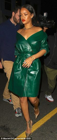 All dressed up:Rihanna added a pair of glam gold heels from Christian Louboutin and a touch of bling with a sparkling choker and matching bracelet