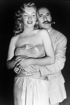 Groucho Marx holding on to a young Marilyn Monroe