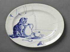 Minton serving dish (1873-1891) at Kingston Lacy, Dorset. One of four different sized oval cat plates, each decorated with a different image of cats.