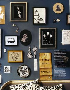 From an old issue of Domino, this almost-black wall dramatically offsets the graphic and gold art collection
