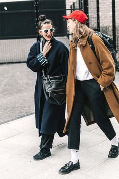 "Fashion girls have totally mastered the art of the ""dad"" details. Tube socks, loafers, baseball hats, and oversize coats all fit the bill."