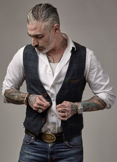 100% cotton yarn dyed twill, lambskin leather details and back, buckleback, 4-button waistcoat. Made in USA Extended sizes available for special order. Contact info@sheehanandcompany.com for more info