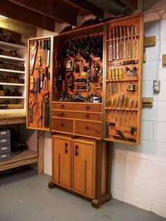 Tool Cabinet - Reader's Gallery - Fine Woodworking  or any similar type of idea from an old wardrobe maybe or build it slightly different for hanging stuff to shut with corkboard. idk.. just brainstorming