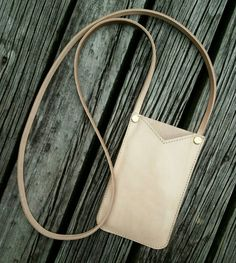 Check out this item in my Etsy shop https://www.etsy.com/listing/464411182/handmade-vege-tan-phone-pouch-custom
