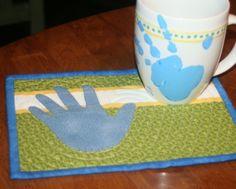 Hand print mug and mug rug.