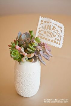Centerpiece idea - Personalized Mexican wedding flags added to a plant favor
