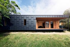 Modern Black And Wood House Cement Siding Ideas The Exterior Of This Is Covered In Fibre Was Clad Desi Timber Battens, Timber Cladding, Exterior Cladding, Building Costs, Building A House, Jackson, Cladding Materials, Inspiration Design, Bathroom Inspiration