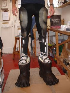 These are the plasterers stilts that I shortened and strengthened with extra bracing and heavier springs to take the weight. I then sculpted some Wookie feet in latex and foamed the stilts inside. The feet articulate and are incredibly stable.