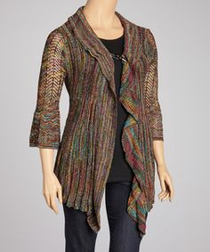 Wonderfully elegant, this beautiful crocheted cardigan provides a warm layer and a chic look that no woman can pass up.