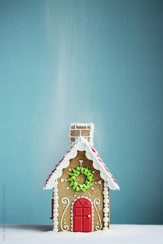 Gingerbread house in a sugar snow shower by Ruth Black - Gingerbread house, Gingerbread - Stocksy United