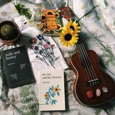 soulmate24.com Photo #rupi_kaur #the_sun_and_her_flowers #milk_and_honey #books #ukulele